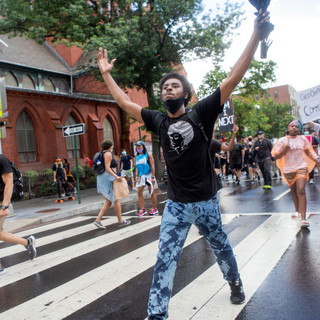 Drew hypes up the crowd while the rain subsides during D.C. Protests' march on Saturday, June 19, 2020.