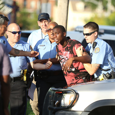 """A man is restrained on the scene of a shooting in New Orleans' Central City neighborhood on June 18, 2016 after charging the """"do not cross"""" tape. (Zach Brien, UptownMessenger.com)"""