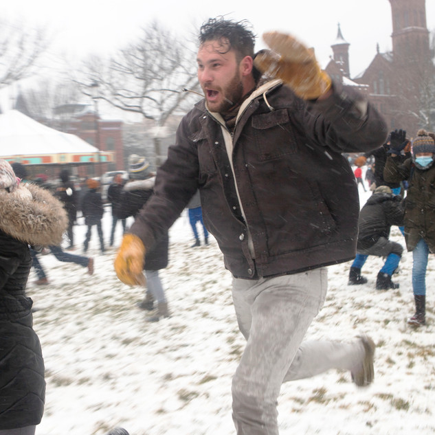 Participants in a snowball fight hosted by the D.C. Snowball Fight Association on the National Mall dodge snowballs as they run to find fresh snow on Sunday, January 31. The event happened when D.C. experienced their biggest snow storm in two years.