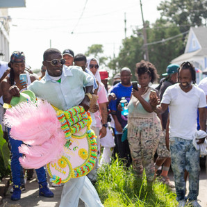 The Uptown Swingers social aid and pleasure club annual second line moves down Magnolia street towards Napoleon avenue in 2019. This photo was made for the Uptown Messenger.