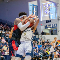 Michael Hughes, Dusquene University junior center, wrestles the ball away from Armel Potter, George Washington University redshirt senior guard, in a game on Saturday, January 11, 2020 in Washington, D.C. The Colonels lost to the Dukes 61 to 66.