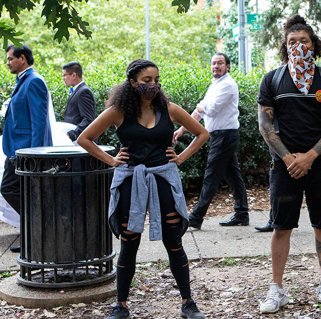 D.C. Protests' co-founder Drew Boddie, right, addresses marchers in Malcolm X Park alongside other members Justin Daniels, center, and Brittany Henderson-Fiestas, left, before their weekly protest on Saturday, September 12.