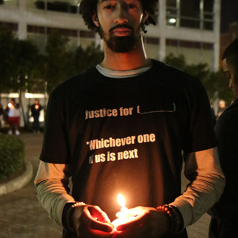 Eddie Murray, Loyola University New Orleans senior, attends a candlelight vigil in honor of those lost to gun violence at the hands of law enforcement. Shot for the Loyola University New Orleans Maroon.
