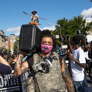 Justin Daniels' stops for a photo during D.C. Protests' march on August 29. The march was larger than normal with people from around the country in the District for the March on Washington held the day before.