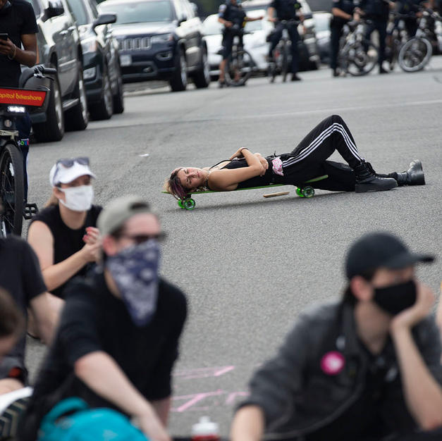 Kat takes a rest on Virginia Avenue NW when D.C. Protests took a break during their march on Saturday, August 22.