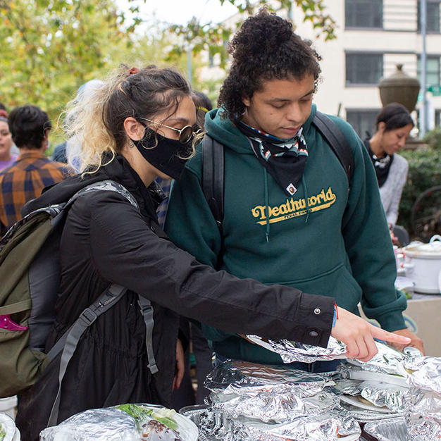 Co-founders Bella Raymond-Paez and Justin Daniels organize meals before D.C. Protests left Malcolm X Park for DuPont Circle on Saturday, October 10. The organization stepped up to serve food for the unhoused population at DuPont Circle when the They/Them Collective, who usually does this, was not able after being raided by U.S. Park Police.
