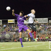 New Orleans Jesters' midfielder Chase Rushing collides with Atlanta Silverbacks' midfielder/wing Mitch Garcia during a match on  July 14, 2017.