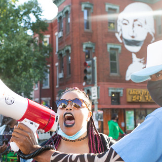 Drew Boddie holds the megaphone for Cass as she calls for the crowd to get loud as D.C. Protests turns from 15th to U street NW. The march tried to get to Adams Morgan, but were stopped by MPD on 18th street.