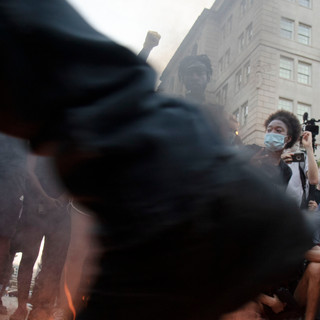 A group of protesters burn American flags at Black Lives Matter Plaza on July 4, 2020.