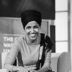 Rep. Ilhan Omar (D-MN) laughs during a live recording of The Deconstructed Podcast, hosted by columnist Mehdi Hasan, at the Jack Morton Auditorium at George Washington University in Washington, D.C. on Wednesday, October 23.