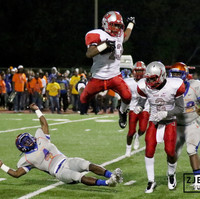 A player from West Jefferson High School goes airborn during a playoff game against LB Landry Walker High School  in New Orleans, La. at Tad Gormley Stadium on Friday, November 6, 2015.