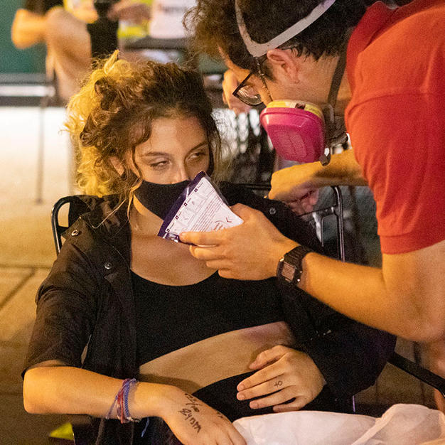 Bella Raymond-Paez, D.C. Protests co-founder, gets treatment from a medic after being struck in the head with a D.C. Metro Police Department bicycle at Black Lives Matter Plaza DC during an Abolish Police direct action on Sunday, August 30.