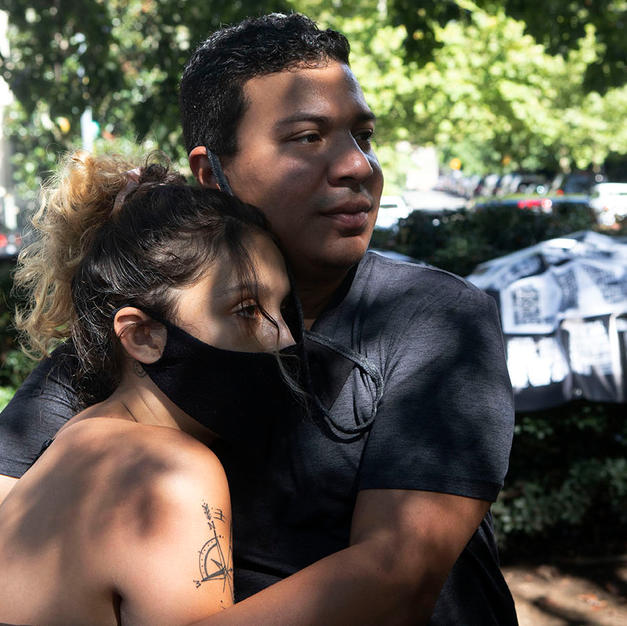 Sergio hugs Bella Raymond-Paez when she arrived to Malcolm X Park before D.C. Protests march on August 29.