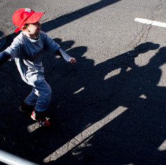 A young fan high-fives the crowd along Constituion avenue during the World Series parade celebrating the Washington Nationals' first ever World Series victory over the Houston Astros.