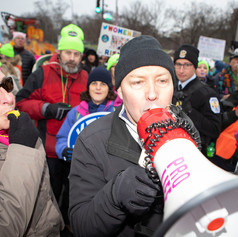 Protesters blow whistles at a pro-life activist during the Women's March on Saturday, January 18.
