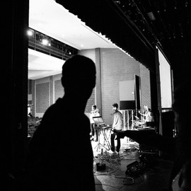 Jim watches the band warm up.