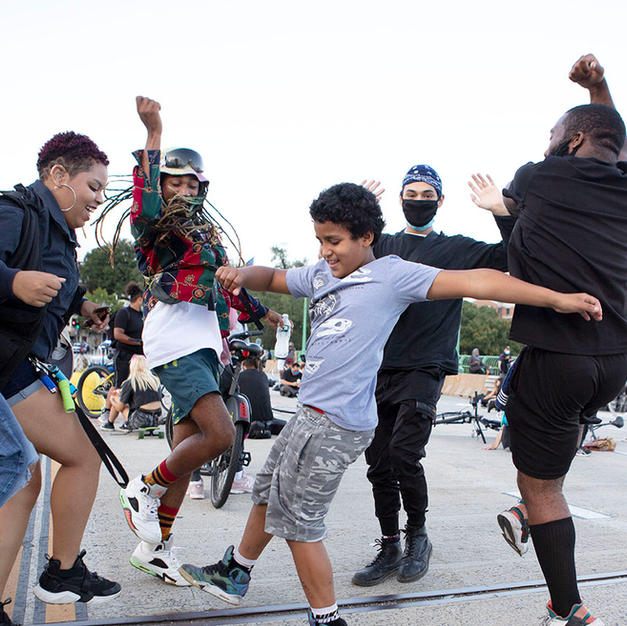 Marchers dance to music on the Francis Scott Key bridge, which connects Washington, D.C. to Arlington, VA, while taking a break during D.C. Protests' march on September 12. D.C. Protests frequently took long breaks on the Key bridge, to maximize their disturbance to public tranquility and make their voice heard.
