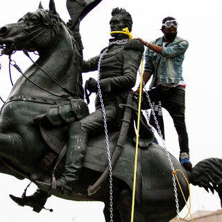 Protesters try to pull down a statue of President Andrew Jackson in Lafayette Square Park on Monday, June 22, 2020 in Washington, D.C. That weekend, protesters in the District toppled and burned a statue of Confederate general Albert Pike.