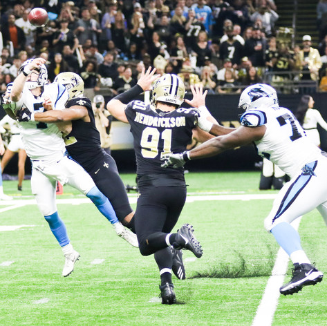 New Orleans Saints defensive end Marcus Davenport hits Carolina Panthers' quarterback Kyle Allen as he throws a pass during a game in the Mercedes Benz Superdome in New Orleans, La. on Sunday, December 30. The Panthers defeated the Saints 33-14 in this week 17 matchup.