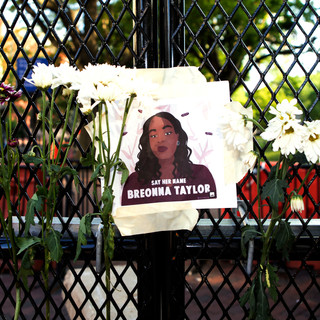 A small memorial to Breonna Taylor is taped on the fence outside of Lafayette Square Park on Saturday, June 6. The fence, which was placed around the park after the first few days of protesting, became home to posters memorializing those killed by police violence, including Breonna Taylor , 26, who was killed in her bed while she was sleeping in Louisville, Ky.