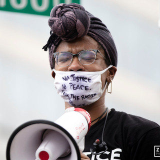 A protester struggles through tears as she delivers a speech on the corner of 18th and Pennsylvania Avenue on Thursday, June 4th in Washington D.C. as the march made its way to the iconic Lincoln Memorial.