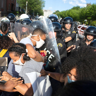 Protesters push back against U.S. Secret Service members clad in riot gear outside of the White House on Saturday, May 30, 2020. That day was the first full day of protesting after the murder of George Floyd.