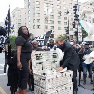 Leaders and clergy release doves at a jazz funeral for victims of police violence at Black Lives Matter Plaza on Sunday, July 5, 2020.
