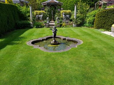 TLGO Mowing small garden.jpg