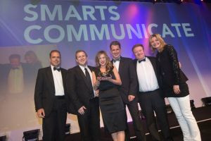 Pictured at the CIPR Excellence Awards in London (from L-R) Andrew Hawkins, founder of award sponsor ComRes; Richard Nelson, Brand Communications Director at Smarts Communicate; Kerri Warnock, Senior Account Manager ; Andrew Campbell, Creative Director; Colin Corbridge, Account Director; and compere for the evening Jo Caulfield