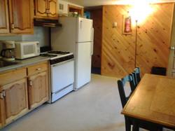 Kitchen of three bedroom log cabin