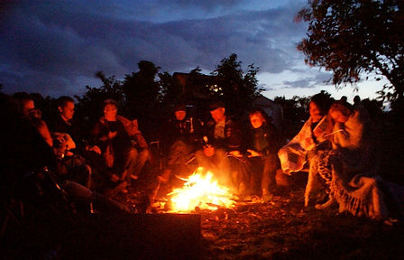 Guests from cabins and hotel lodging gathered around the campfire in Catskills