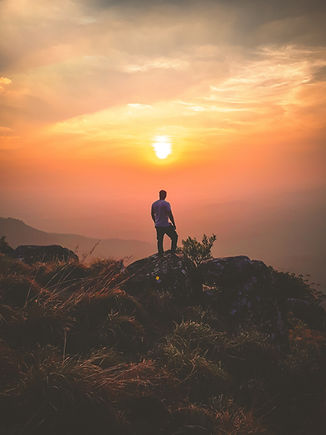 man-standing-on-rock-during-sunset-90653