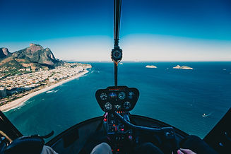 photo-of-person-flying-a-helicopter-2868