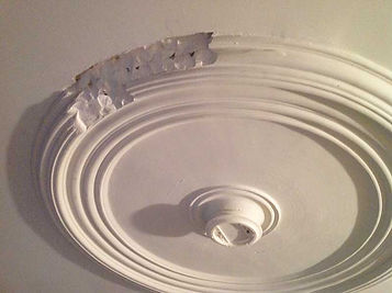 Unrestored and damaged plaster ceiling medallion