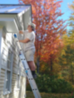 Mike Dever painting a home exterior