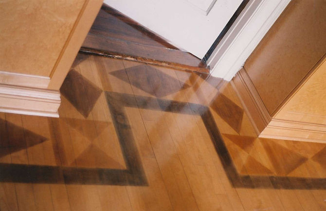 faux marquetry pattern on a hardwood floor