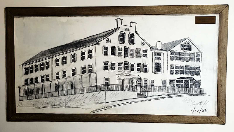 An artist's drawing of the Middlebury Inn in pencil on the wall of the Inn