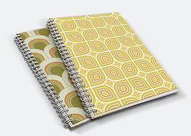 Two ringbound notebooks with 70s inspired geometric patterned covers.