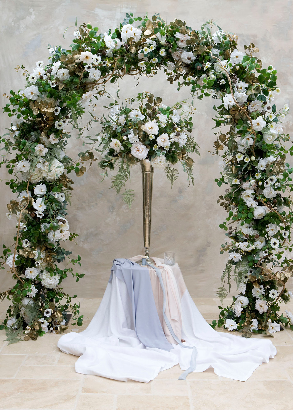 Winter wedding faux floral arch and table centrepiece for hire, Essex