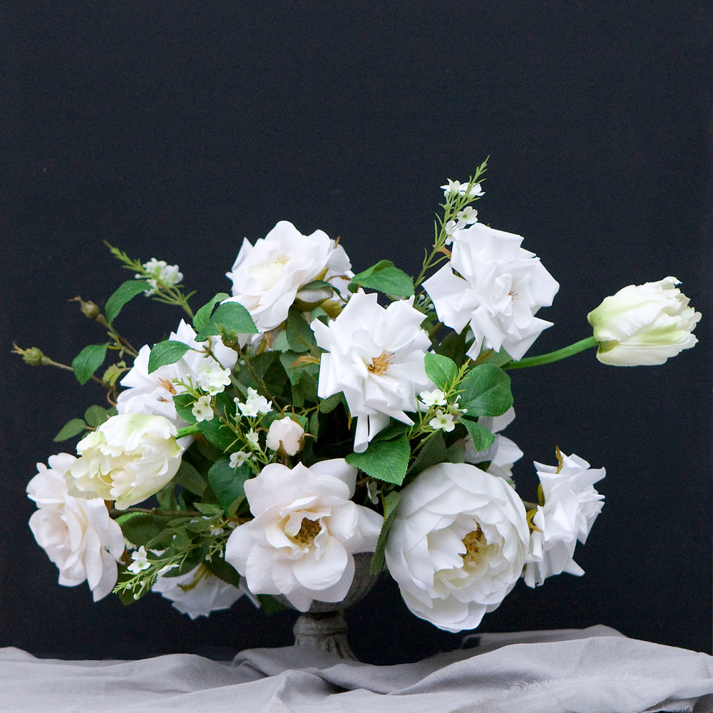 Faux flower spring table centrepiece for hire in Essex
