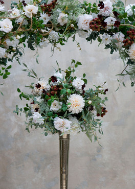 Faux flower arch and tablecentre for hire for weddings and events in Essex