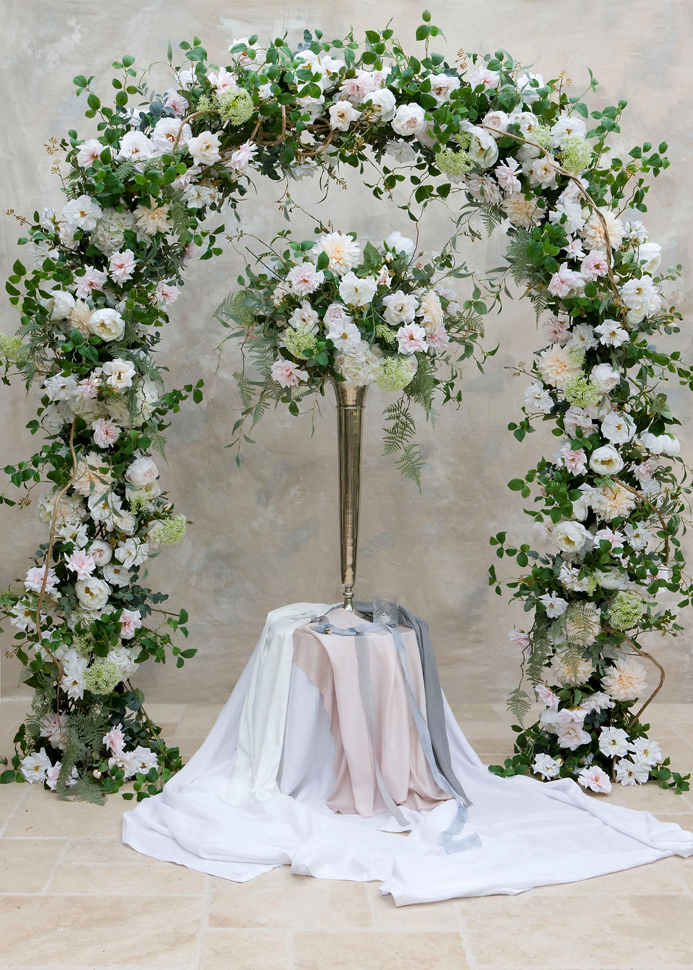 Summer Wedding Faux flower arch and Table Centrepiece for hire in Essex