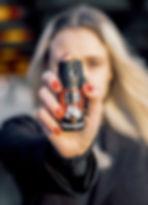 Woman using pepper spray that contain capsaicin