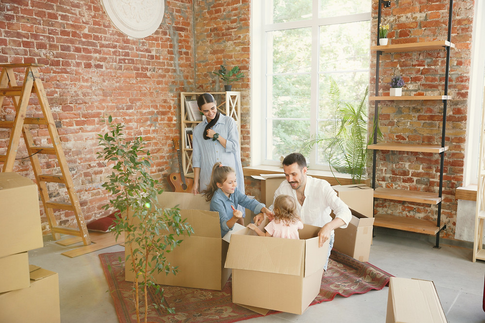 family enjoying unpacking in their new long term rental property