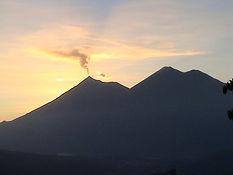 Volcano Fuego Erupting in sunset Guatemala