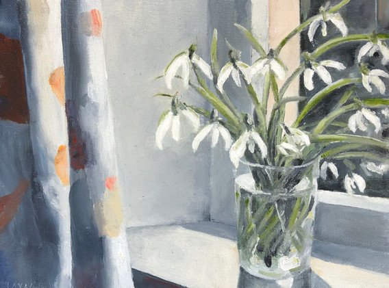 Window sill with snowdrops