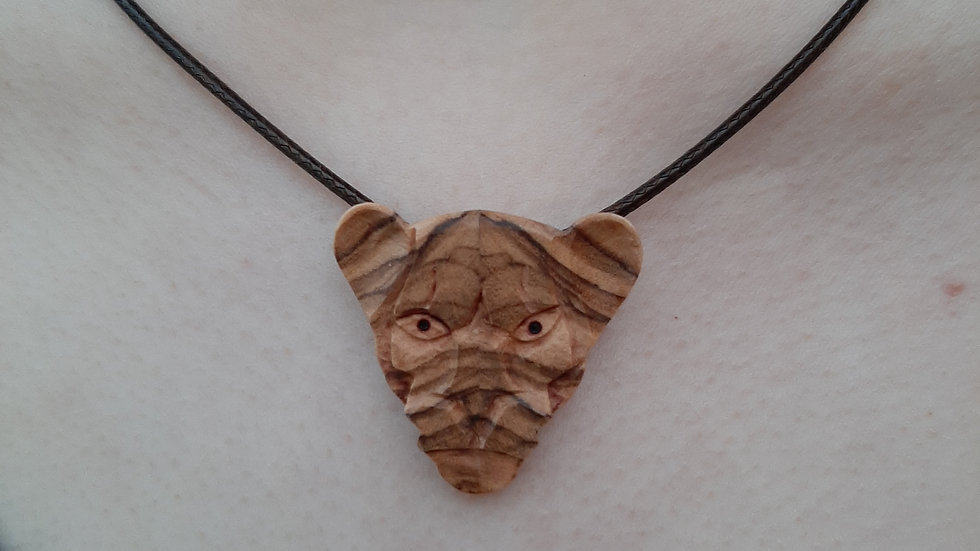 Tiger necklace carved from Olivewood.