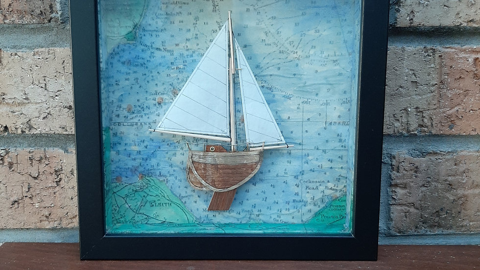 Small sailing boat in relief