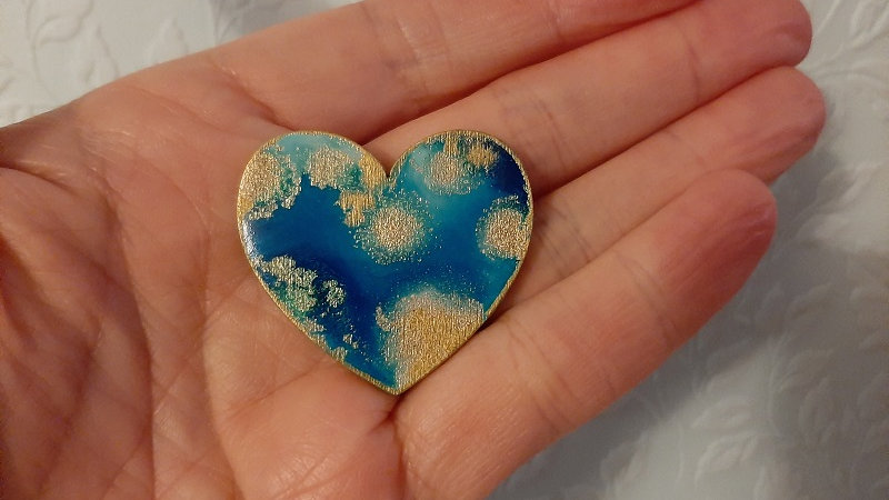 Heart brooches made from wood and coloured Resin.