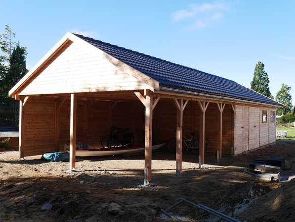 Carport Bausatz groß mit Satteldach und integriertem Schuppen